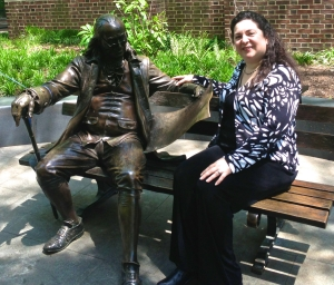 Diana takes a moment to discuss things with her pal Ben Franklin.