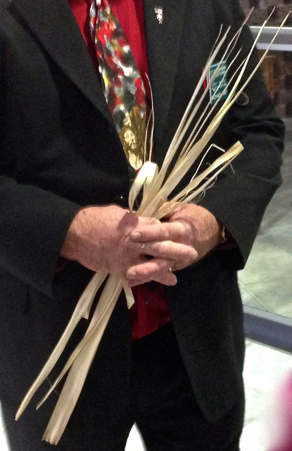 Prayerful hands with palm fronds. (c) Diana Belchase